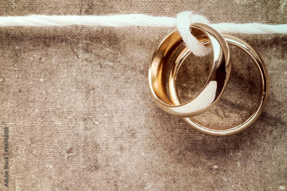 Fototapety, obrazy: Golden rings hanging on rope