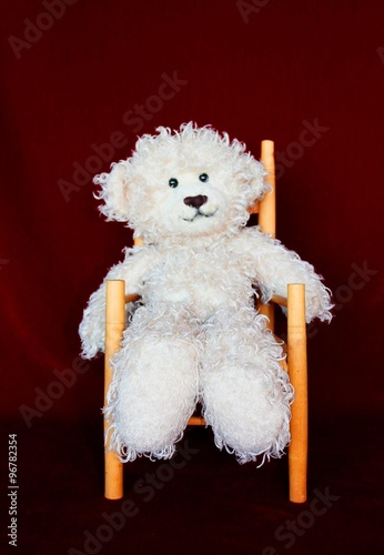 Photo  WHITE FUZZY BEAR SITTING ON A CHAIR GREAT FOR CHILDREN'S ROOM