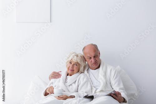 Fototapety, obrazy: Elderly romantic couple in bedroom