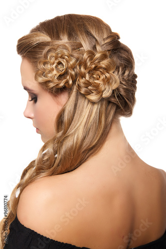 portrait of a beautiful young blonde woman on a light background with hairdo on her head. copy space. - 96810774