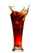 Splashing cola in glass