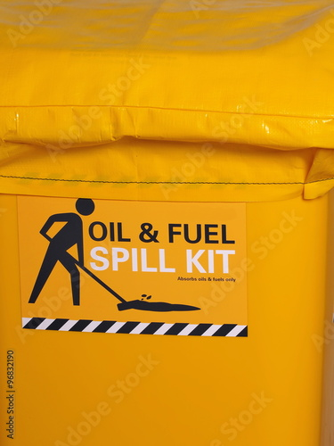 Fotografia  Labeled bright yellow industrial emergency spill kit, Australia 2015