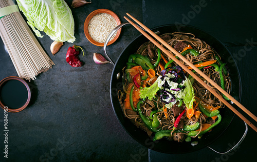 Soba noodles with beef, carrots, onions and sweet peppers
