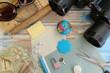 notebooks, binoculars, sunglasses, pen, key, padlock, globe and shell on wooden background