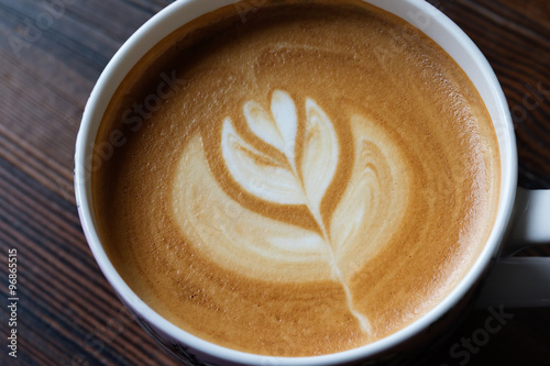 Fotografie, Obraz  Cup of Latte Art Coffee on Wooden Table