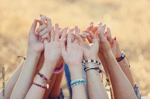 Fotografía  Friends hands raised up, outdoors