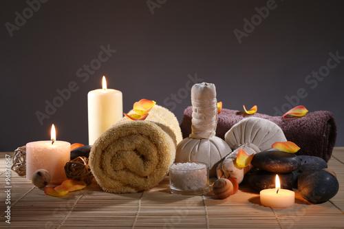Beautiful spa set on wicker napkin on dark background