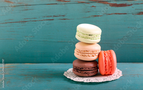 Staande foto Macarons Macarons on blue wooden background,