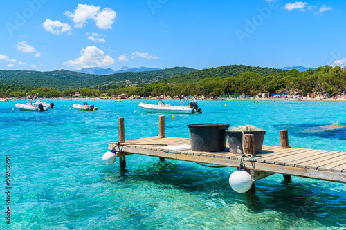 Foto op Plexiglas Caraïben Wooden jetty and azure sea water of Santa Giulia bay, Corsica island, France