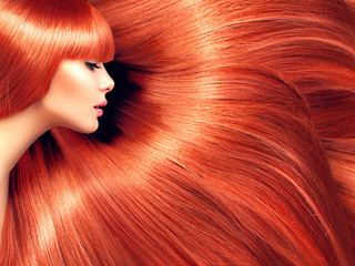 Fototapeta Do fryzjera Beautiful hair. Beauty woman with long red hair as background