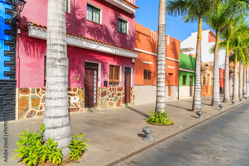 Fotobehang Havana Colourful houses and palm trees on street in Puerto de la Cruz town, Tenerife, Canary Islands, Spain