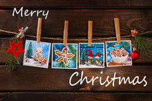 Four Christmas Cards Hanging On Rope Against Wooden Background