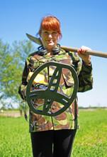 Girl With Metal Detector. Treasure Hunter