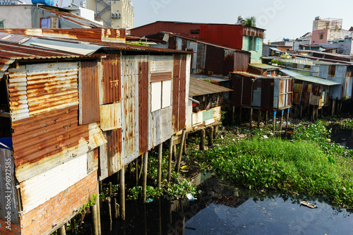 Fototapety, obrazy: Colorful squatter shacks at Slum Urban Area in Ho Chi Minh City, Vietnam. Ho Chi Minh city (aka Saigon) is the largest city and economic center in Vietnam with population around 10 million people.