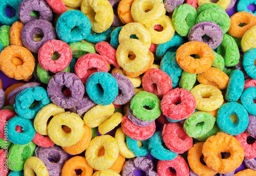 Photo Colorful cereal  on a purple  background