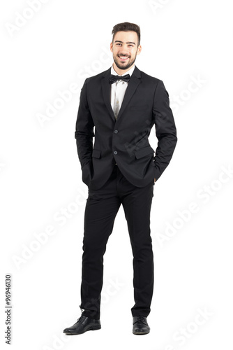 Fotografie, Obraz  Laughing happy young man in tuxedo with bow tie looking at camera