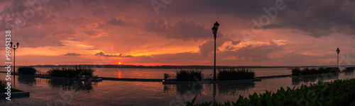City on the water Wide panorama of Volga river embankment in Samara city after rain during sunset, Russia