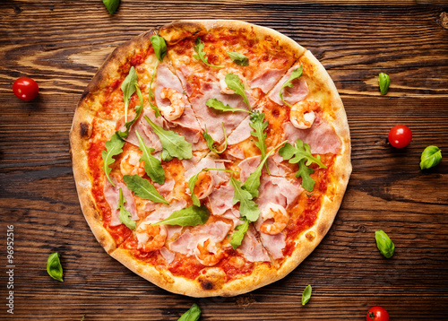 Delicious italian pizza served on wooden table #96952516