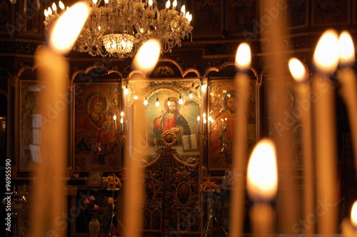 Canvas Print Burning candles in orthodox church