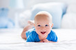 canvas print picture - Baby boy in white sunny bedroom