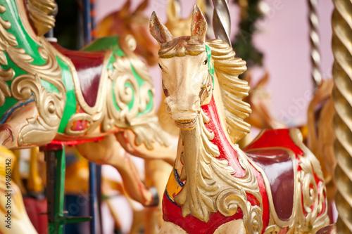 Fotografie, Obraz  Carousel. Horses on a carnival Merry Go Round.