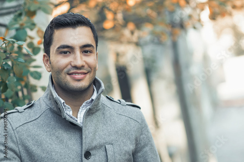 Fotografie, Obraz  Portrait od smiling gorgeous young attractive man, outdoor - outside coldly morn