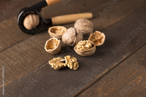 walnuts with nutcracker on a rustic table