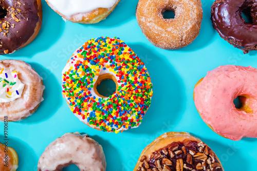 Deurstickers Dessert Assorted donuts on pastel blue background