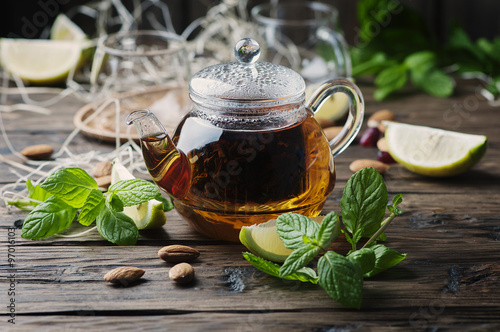 Canvas Prints Tea Hot black tea with lemon and mint on the wooden table