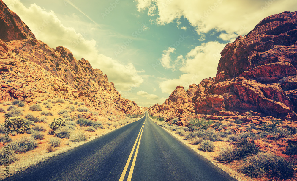 Fototapeta Retro stylized desert highway, travel adventure concept.