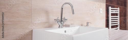Fotografía  Porcelain washbasin on beige background
