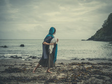 Vintage Shot Of Woman On Beach With Baby