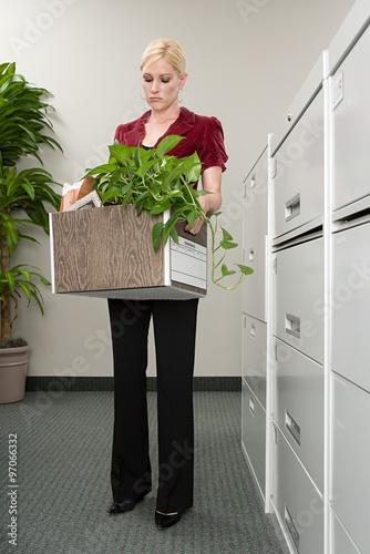 Fototapeta Woman with box of belongings obraz na płótnie