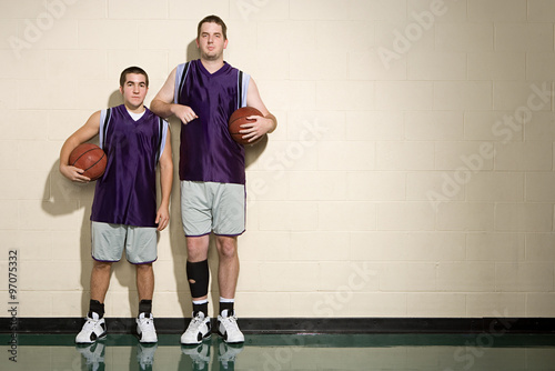 Fotografie, Obraz  Tall and short basketball players