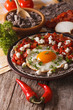 Mexican breakfast: huevos rancheros close-up. vertical