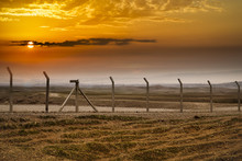 Fence At Sunset Time In Iraqi Desert At Winter Season