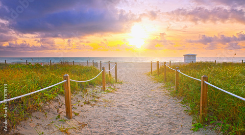 Staande foto Strand Path on the sand going to the ocean in Miami Beach Florida at sunrise or sunset, beautiful nature landscape, retro instagram filter for vintage looks