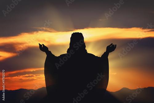 Fotografía  Silueta de Jesús y la puesta de sol