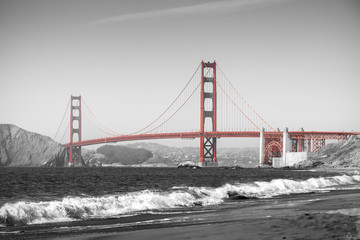 Fototapeta Mosty Red Golden Gate Bridge in San Francisco, black and white filter