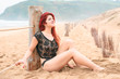 girl in black lingerie walks along the beach a cloudy day