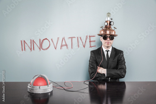 Fotografiet  Innovative concept with vintage businessman and calculator
