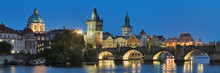 Prague, Czech Republic. Evening Panorama Of The Charles Bridge With Dome Of The Saint Francis Of Assisi Church, Old Town Bridge Tower, Old Town Water Tower, Dome Of The National Theatre.