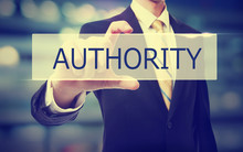 Business Man Holding Authority...