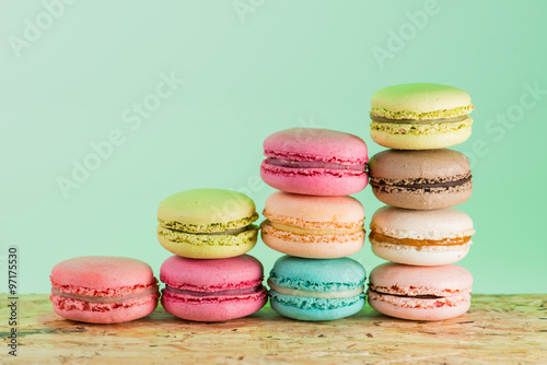 Staande foto Macarons series Colorful and tasty French cookies Macarons on a colorful