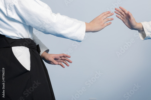 Photo Stands Martial arts Hands of two girls standing in stance on martial arts training
