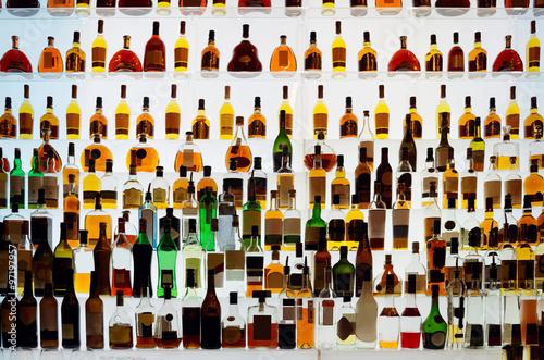 Obraz Various alcohol bottles in a bar - fototapety do salonu