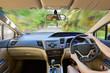 Close up interior driver inside bright car.