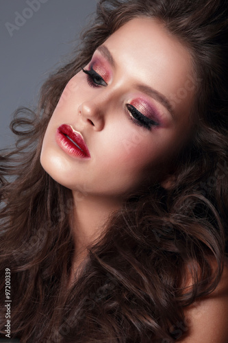 Portrait of a young woman, close-up, bright makeup, eye shadow. Canvas Print