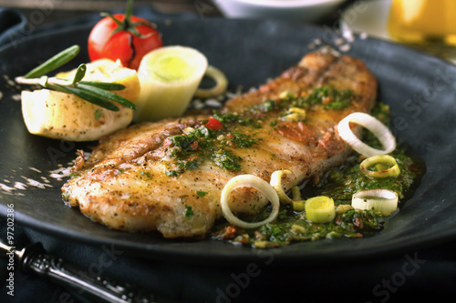 Staande foto Vis Grilled fish with lemon and rosemary