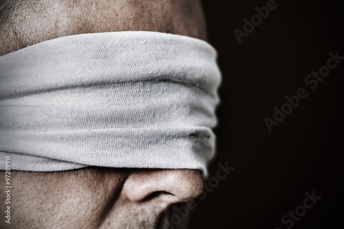 young man with a blindfold in his eyes Wallpaper Mural